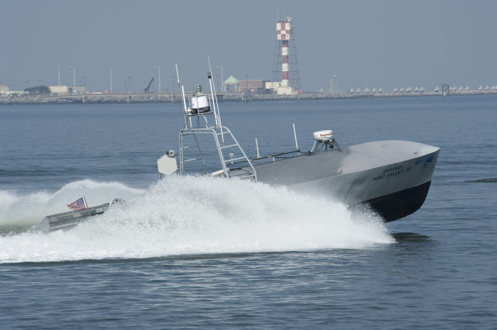 110720-N-ZZ999-007 FORT MONROE, Va. (July 20, 2011) A common unmanned surface vehicle patrols for intruders during Trident Warrior 2011. The experimental boat can operate autonomously or by remote. The Trident Warrior experiment, directed by U.S. Fleet Forces Command, temporarily deploys advanced capabilities on ships to collect real-world data and feedback during an underway experimentation period. (U.S. Navy photo by Mass Communication Specialist Seaman Scott Youngblood/Released)